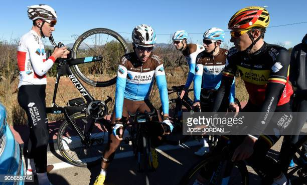 La Mondiale's Swiss cyclist Silvan Dillier Alex Dumont and Belgian teammate Oliver Naesen attend a training session in Castellon on January 16 2018 /...