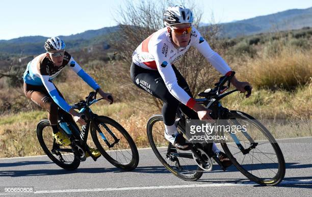 La Mondiale's Swiss cyclist Silvan Dillier and France's Romain Bardet ride during a training in Castellon on January 16 2018 / AFP PHOTO / JOSE JORDAN