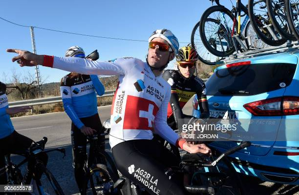 La Mondiale's Swiss cyclist Silvan Dillier speaks with Belgian teammate Oliver Naesen during a training in Castellon on January 16 2018 / AFP PHOTO /...