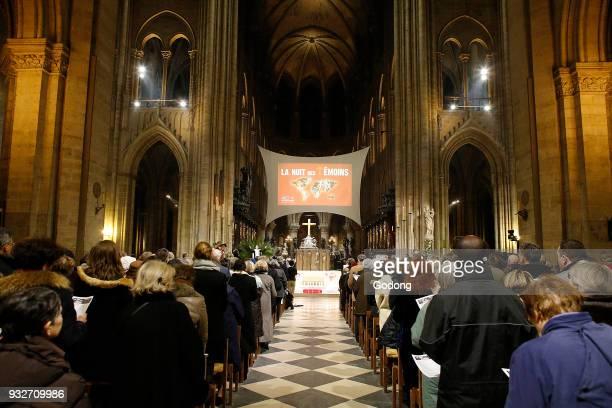 La Nuit des Temoins vigil for today's Christian martyrs in Notre Dame cathedral Paris France