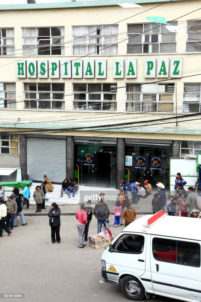 people queuing in front of the hospital.