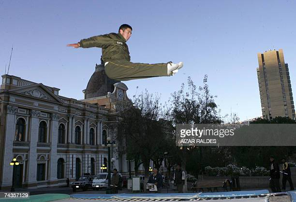 A policeman exercises on a trampoline during a demonstration against FIFA's decision to ban international matches played at stadiums like La Paz in...