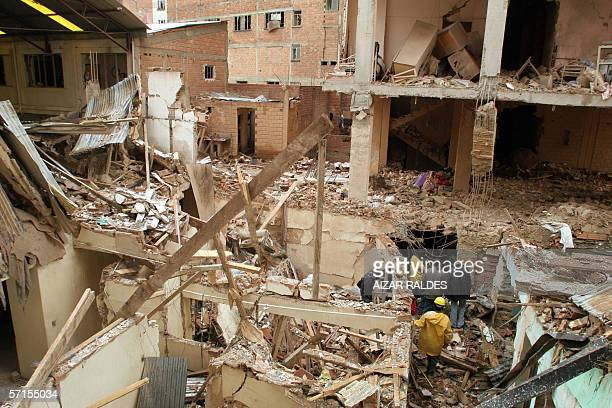 Policemen inspect among the rubble left by an explosion at the Risinho hotel in central La Paz 22 March 2006 Blasts at two hotels in La Paz killed...