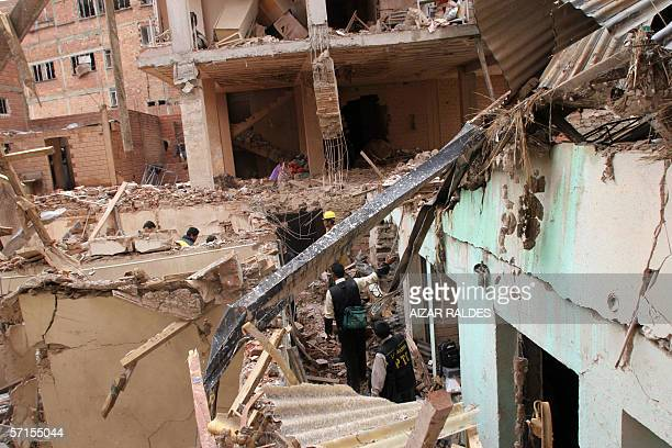 Policemen walk among the rubble left by an explosion at the Risinho hotel in central La Paz 22 March 2006 Blasts at two hotels in La Paz killed two...