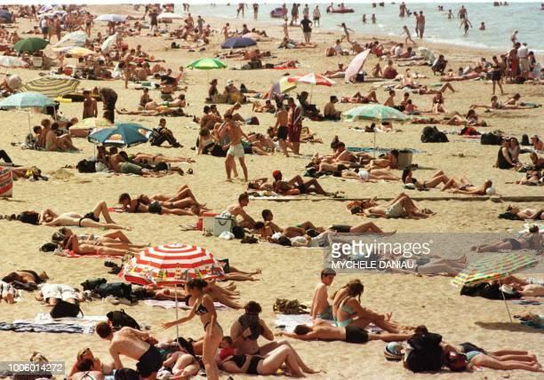 La plage de Cabourg est envahie par les touristes en ce premier jour de vacances pour les aoutiens
