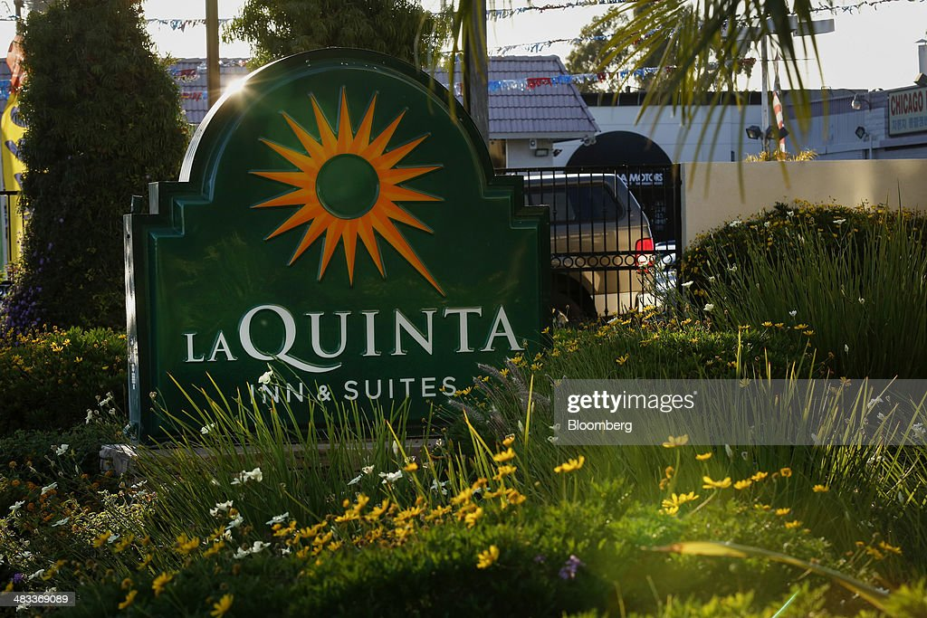 La Quinta Holdings Inc Signage Is Displayed Outside Of A Hotel Location In Hawaiian  Gardens California