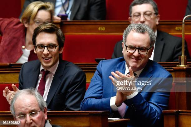 La Republique en Marche deputies Richard Ferrand and Pacome Rupin applaud during a session of questions to the government at the National Assembly in...
