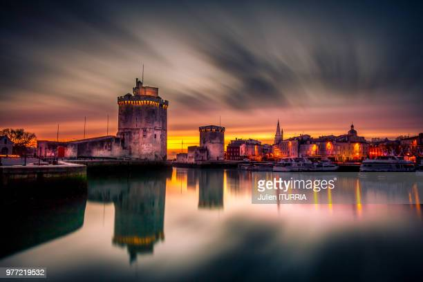 la rochelle and harbor towers, france - la rochelle stock pictures, royalty-free photos & images