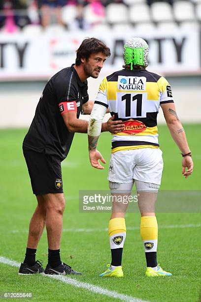 La Rochelle backs coach Xavier Garbajosa gives some advice to Gabriel Lacroix of La Rochelle during the Top 14 match between Stade Francais and Stade...