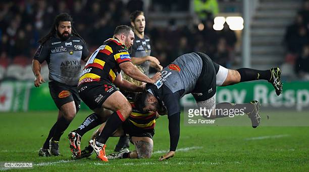 La Rochelle player Mohamed Boughanmi goes flying as he is tackled by Richard Hibbard of Gloucester during the European Rugby Challenge Cup match...