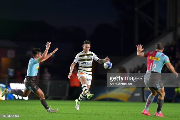 La Rochelle's English flyhalf Ryan Lamb chips the ball upfield during the European Rugby Champions Cup rugby union round 1 pool match between...