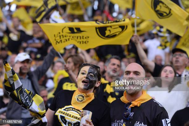 La Rochelle's fans cheer for their team prior to the start of the French Top 14 semifinal rugby union match between Toulouse and La Rochelle on June...
