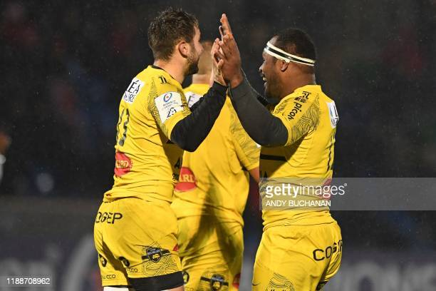La Rochelle's Fijian centre Levani Botia celebrates after scoring their second try during the European Rugby Champions Cup Group B match between...
