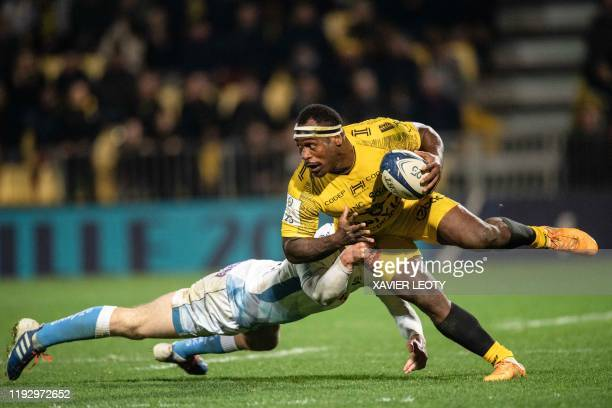 La Rochelle's Fijian centre Levani Botia runs with the ball during the European Rugby Champions Cup match between La Rochelle and Sale Sharks at the...