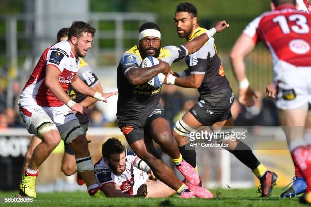 La Rochelle's Fijian centre Levani Botia runs with the ball during the European Champions Cup rugby union match between La Rochelle and Ulster on...