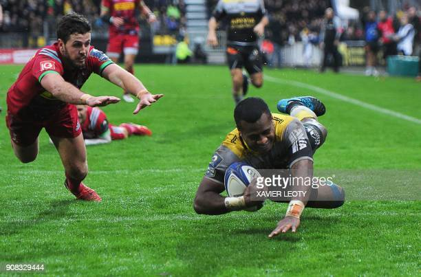 TOPSHOT La Rochelle's Fijian fullback Kini Murimurivalu dives and scores a try as Harlequins' Australian fullback Ian Prior jumps to tackle during...
