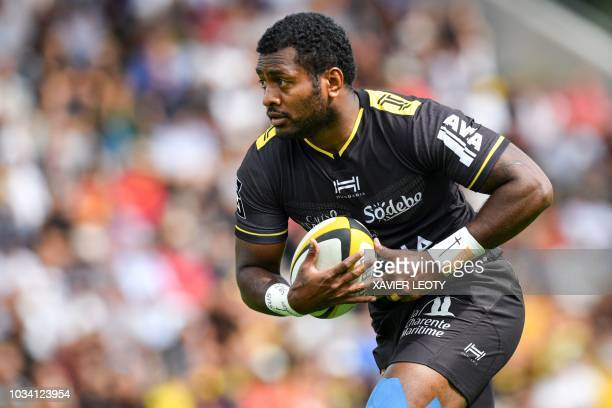 La Rochelle's Fijian fullback Kini Murimurivalu runs with the ball during a French Top 14 rugby union match between La Rochelle and Perpignan on...