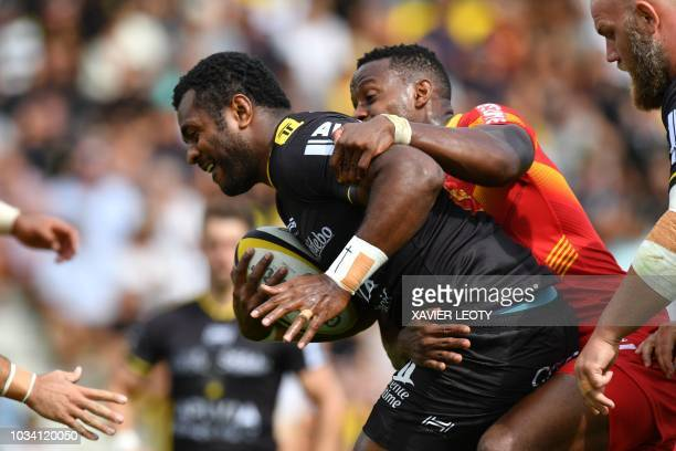 La Rochelle's Fijian fullback Kini Murimurivalu runs with the ball during French Top 14 rugby union match between La Rochelle and Perpignan on...