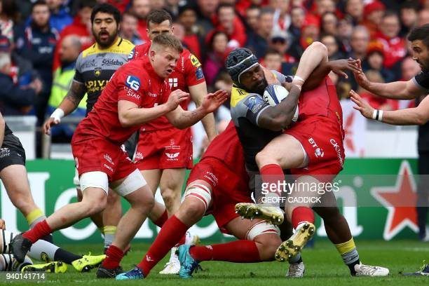 La Rochelle's flanker Botia Veivuke is tackled during the European Champions Cup rugby union quarter final match between Scarlets and La Rochelle at...