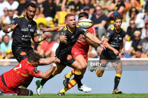 La Rochelle's fly-half Ihaia West from New Zealand runs with the ball during a French Top 14 rugby union match between La Rochelle and Perpignan on...