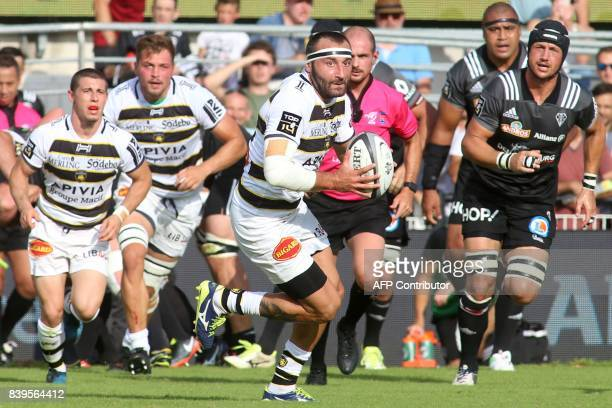 La Rochelle's flyhalf Jeremy Sinzelle runs with the ball during the French Top 14 rugby union match CA Brive vs Castres on august 26 2017 at the...