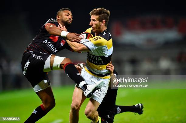 La Rochelle's French center Vincent Rattez vies with La Rochelle's French fullback Arthur Retiere during the French Top 14 rugby union match between...