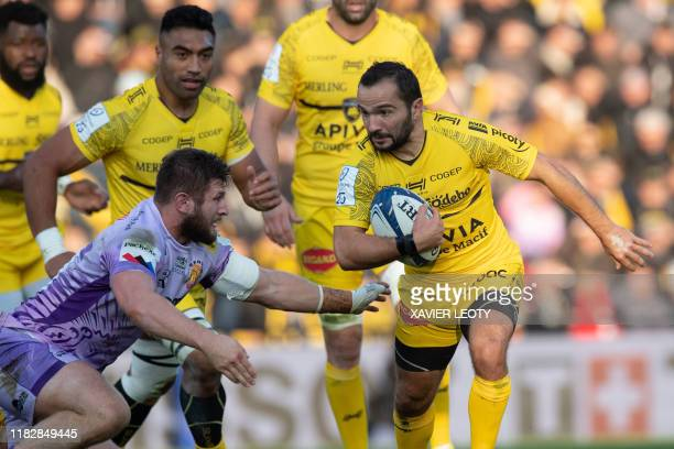 La Rochelle's French centre Alexis Bales runs with the ball during the first round of the European champions cup match between La Rochelle and Exeter...
