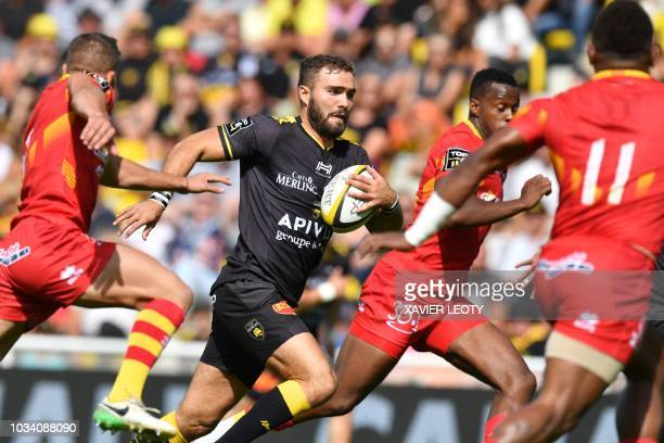 La Rochelle's French centre Eliott Roudil runs with the ball during a French Top 14 rugby union match between La Rochelle and Perpignan on September...