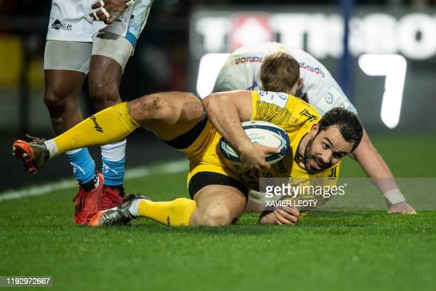 La Rochelle's French centre Geoffrey Doumayrou holds the ball on the ground during the European Rugby Champions Cup match between La Rochelle and...