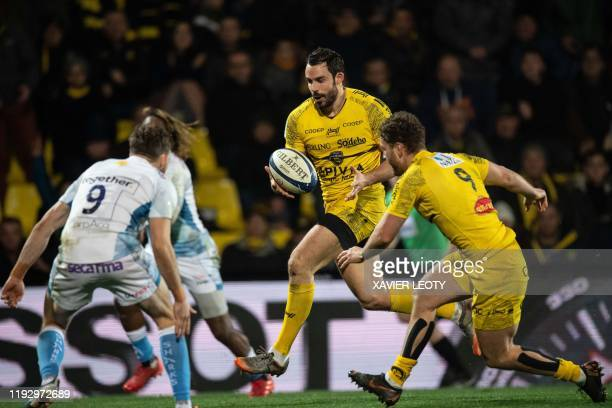 La Rochelle's French centre Geoffrey Doumayrou runs with the ball during the European Rugby Champions Cup match between La Rochelle and Sale Sharks...