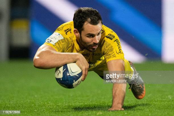 La Rochelle's French centre Geoffrey Doumayrou scores a try during the European Rugby Champions Cup match between La Rochelle and Sale Sharks at the...