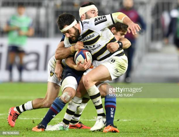 TOPSHOT La Rochelle's French centre Pierre Aguillon is tackled during the French Top 14 rugby union match between BordeauxBegles and La Rochelle at...