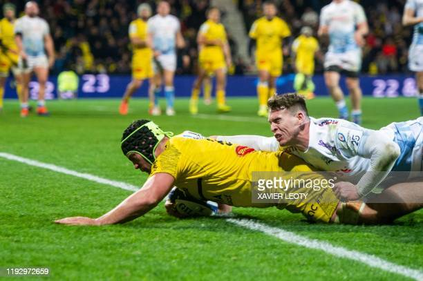 La Rochelle's French flanker Greg Alldritt is tackled during the European Rugby Champions Cup match between La Rochelle and Sale Sharks at the Marcel...