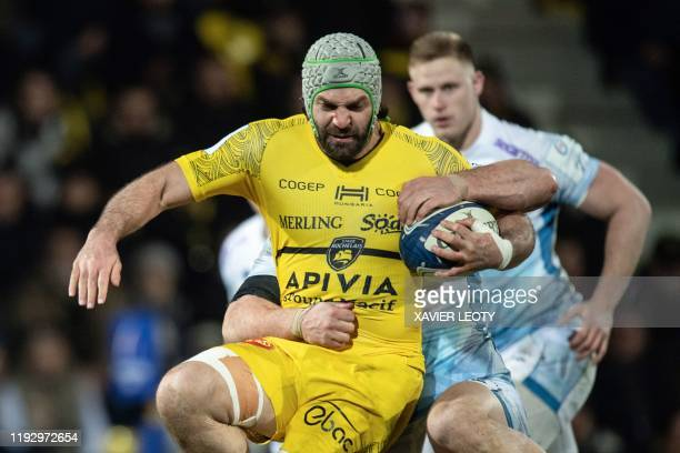 La Rochelle's French flanker Kevin Gourdon runs with the ball during the European Rugby Champions Cup match between La Rochelle and Sale Sharks at...
