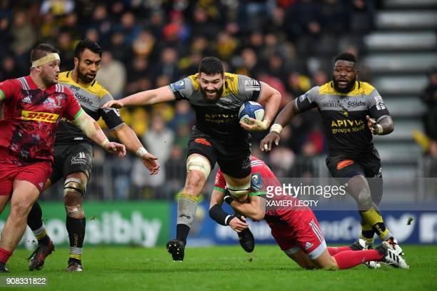 La Rochelle's French flanker Mathieu Tanguy runs with the ball during the European Champions Cup rugby union match between La Rochelle and Harlequins...
