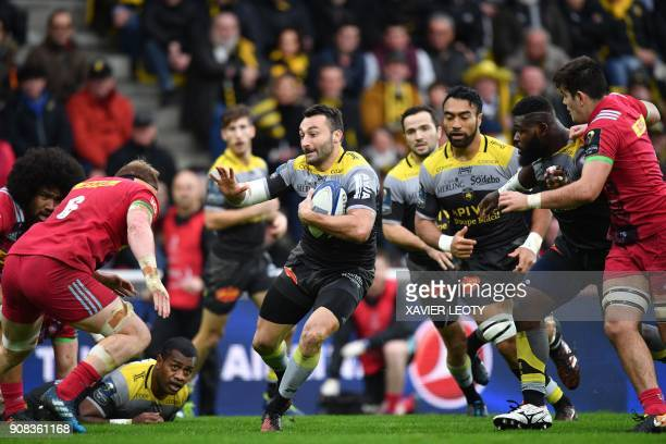 La Rochelle's French flyback Jeremy Sinzelle runs with the ball during the European Champions Cup rugby union match between La Rochelle and...