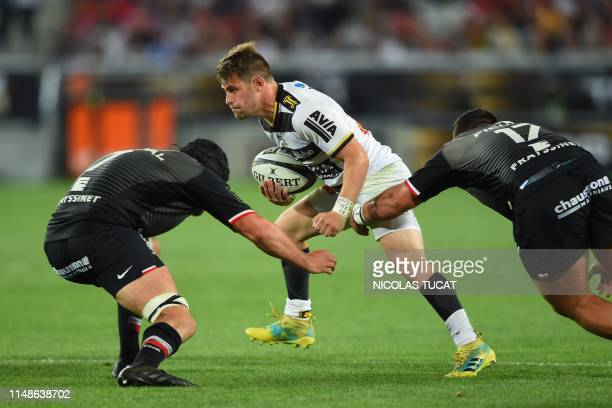 La Rochelle's French full back Arthur Retiere is tackled during the French Top 14 semifinal rugby union match between Toulouse and La Rochelle on...