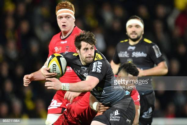 La Rochelle's French fullback Arthur Retiere runs with the ball during the French Top 14 rugby union match between La Rochelle and Lyon on March 17...