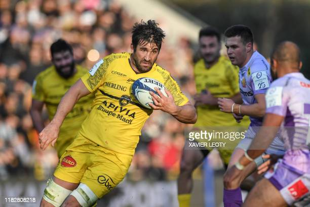 La Rochelle's French lock Romain Sazy runs with the ball during the first round of the European champions cup match between La Rochelle and Exeter...