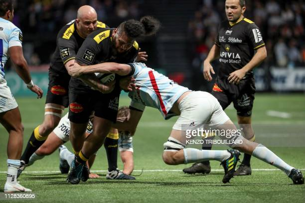 La Rochelle's French prop Vincent Pelo fights for the ball with Racing92's Scottish flyhalf Finn Russell during the French Top 14 rugby union match...