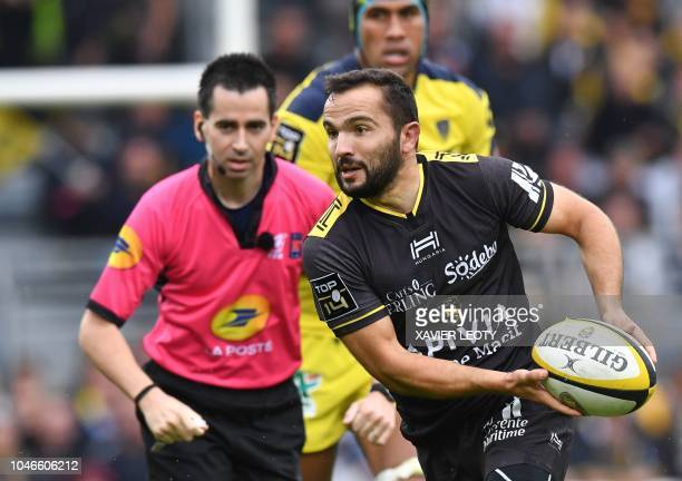 La Rochelle's French scrum half Alexi Bales passes the ball during the French Top 14 rugby union match between La Rochelle and Clermont at the Marcel...