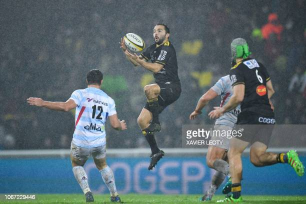 La Rochelle's French scrumhalf Alexi Bales catches the ball during the French Top 14 Rugby union match between La Rochelle and Racing 92 at the...