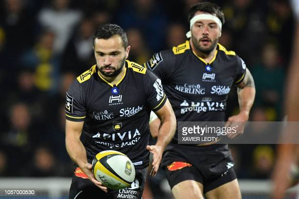 La Rochelle's French scrumhalf Alexi Bales runs with the ball on the pitch during the French Top 14 rugby union match between La Rochelle and Agen at...