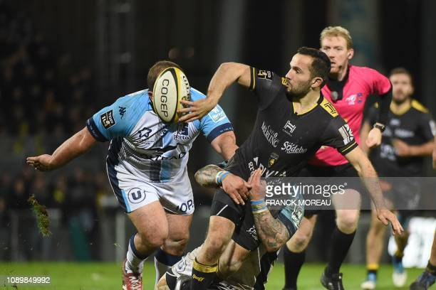 La Rochelle's French scrumhalf Alexi Bales tries to avoid a tackle during the French Top 14 rugby union match between La Rochelle and Montpellier at...