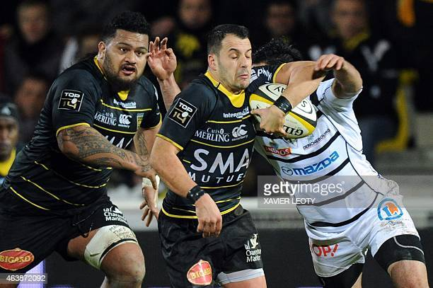 La Rochelle's French scrumhalf Julien Audy runs with the ball next to La Rochelle's French prop Vincent Pelo during the French Top 14 rugby union...