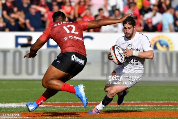 La Rochelle's French wing Arthur Retiere runs with the ball during the French Top 14 rugby union match between Toulon and La Rochelle on October 6 at...