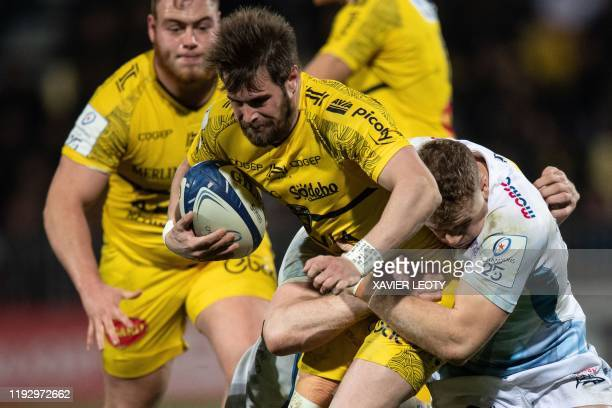 La Rochelle's French wing Arthur Retiere runs with the ball during the European Rugby Champions Cup match between La Rochelle and Sale Sharks at the...