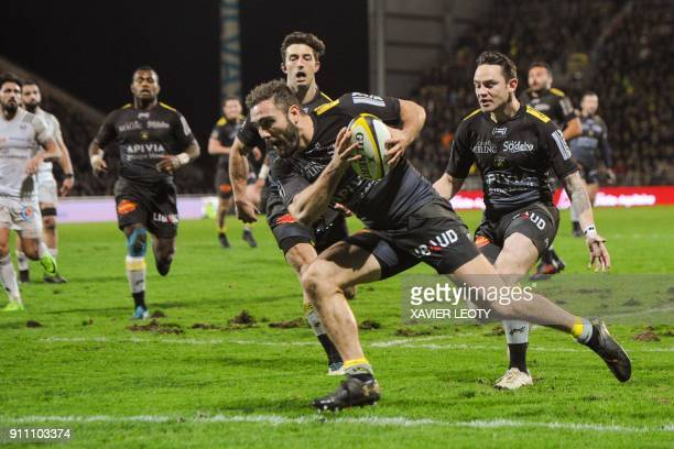 La Rochelle's French wing Eliott Roudil scores a try during the French Top 14 rugby union match between La Rochelle and Brive on January 27, 2018 at...