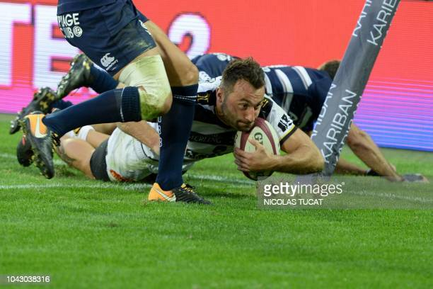 La Rochelle's French wing Jeremy Sinzelle scores a try during the French Top 14 rugby union match between Bordeaux-Begles and La Rochelle on...