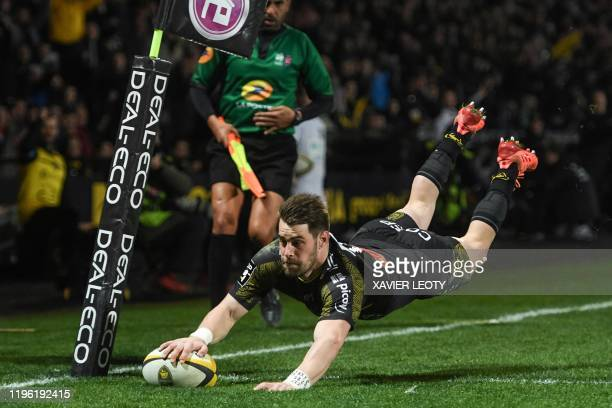 La Rochelle's French winger Arthur Retiere scores a try during the French Top 14 rugby union match between Stade Rochelais and Montpellier Herault...